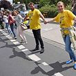 "Participants of the anti-nuclear ""Chain Reaction"" demonstration build a human chain to protest against the operation of Belgium's Thihange 2 and the Netherland's Doel 3 nuclear power plants on June 25, 2017 in Aachen, western Germany, close to the border with Belgium and the Netherlands. / AFP PHOTO / dpa / Henning Kaiser / Germany OUT"