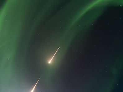 This NASA photo shows a NASA Black Brant IX sounding rocket as it soars skyward into an aurora over Alaska following a 5:13 am EST, February 22, 2017 launch from the Poker Flat Research Range in Alaska.  The rocket carried an Ionospheric Structuring: In Situ and Groundbased Low Altitude StudieS (ISINGLASS) instrumented payload examining the structure of an aurora. ISINGLASS includes the launch of two rockets with identical payloads that will fly into two different types of auroras � an inverted-V arc and a dynamic Alfenic curtain. The launch window for the second rocket runs through March 3. / AFP PHOTO / NASA / Handout / RESTRICTED TO EDITORIAL USE - MANDATORY CREDIT AFP PHOTO / NASA/TERRY ZAPERACH - NO MARKETING - NO ADVERTISING CAMPAIGNS - DISTRIBUTED AS A SERVICE TO CLIENTS
