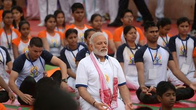 Indian Prime Minister Narendra Modi (C) participates in a mass yoga session along with other Indian yoga practitioners to mark the 3rd International Yoga Day at Ramabhai Ambedkar Sabha Sthal in Lucknow on June 21, 2017.