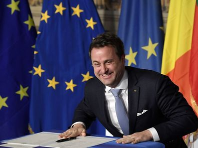 Luxembourg's Prime Minister Xavier Bettel reacts as he signs the new Rome declaration with leaders of 27 European Union countries special during a summit of EU leaders to mark the 60th anniversary of the bloc's founding Treaty of Rome, on March 25, 2017 at Rome's Piazza del Campidoglio (Capitoline Hill).   Against a backdrop of crises and in the absence of the departing Britain, the leaders signed a new Rome declaration, six decades after the six founding members signed the Treaty of Rome and gave birth to the European Economic Community.  / AFP PHOTO / Tiziana FABI