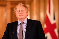 Prime Minister Boris Johnson gives a press conference on the ongoing COVID-19 situation in London on March 16, 2020. (Photo by Richard Pohle / POOL / AFP)