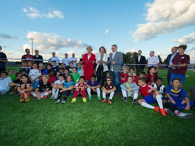 Young footballers pose for a photo at the inauguration for the new look Prince Jean stadium in Luxembourg Merl
