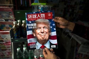 "TOPSHOT - A copy of the local Chinese magazine Global People with a cover story that translates to ""Why did Trump win"" is seen with a front cover portrait of US president-elect Donald Trump at a news stand in Shanghai on November 14, 2016.   Chinese President Xi Jinping and US president-elect Donald Trump agreed November 14 to meet ""at an early date"" to discuss the relationship between their two powers, Chinese state broadcaster CCTV said.  / AFP PHOTO / JOHANNES EISELE"