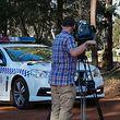 11.05.2018, Australien, Osmington: Ein Kameramann filmt die Farm inAustralien, auf der am Freitag sieben Leichen gefunden wurden. Vermutlich handelt es sich um ein Familiendrama. Die toten vier Kinder und drei Erwachsenen wurden auf einem Grundstück in der kleinen Gemeinde Osmington im Südwesten des Kontinents, 260 km von Perth entfernt, entdeckt. Foto: Richard Wainwright/AAP/dpa +++ dpa-Bildfunk +++