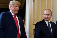 "(FILES) In this file photo taken on July 16, 2018 US President Donald Trump (L) and Russian President Vladimir Putin arrive for a meeting in Helsinki. US President Donald Trump insisted July 18, 2018 that his meeting with Vladimir Putin could prove successful, as he tries to quell fury in Washington after appearing to defer to the Russian leader over US intelligence chiefs.The Republican president claimed his meeting with Putin -- who he seemed to warmly embrace, triggering outrage in Washington -- could prove ""an even greater success"" than his one last week with traditional allies NATO, adding that his counterpart had agreed to assist US negotiation efforts with North Korea.  / AFP PHOTO / Brendan Smialowski"