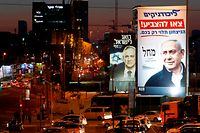 TOPSHOT - A Blue and White (Kahol Lavan) political alliance electoral billboard shows the portrait of retired general Benny Gantz (L), one of the leaders of the Blue and White, and a Likud electoral billboard shows the portrait of Israeli Prime Minister Benjamin Netanyahu, leader of the Likud party, on February 26, 2020 in the Israeli city of Bnei Brak. (Photo by JACK GUEZ / AFP)