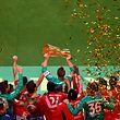 Bayern Munich players celebrate Bayern Munich's German goalkeeper Manuel Neuer lifting  the trophy after the German Cup (DFB Pokal) Final football match RB Leipzig v FC Bayern Munich at the Olympic Stadium in Berlin on May 25, 2019. (Photo by John MACDOUGALL / AFP) / DFB REGULATIONS PROHIBIT ANY USE OF PHOTOGRAPHS AS IMAGE SEQUENCES AND QUASI-VIDEO.