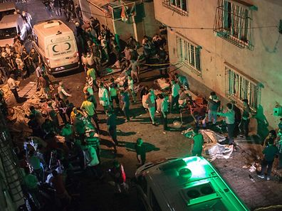 Ambulances arrive at the site of an explosion on in Gaziantep following a late night militant attack on a wedding party in southeastern Turkey.