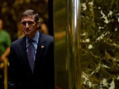 "(FILES) This file photo taken on December 12, 2016 shows Lt. Gen. Michael Flynn arriving for a meeting with US President-elect Donald Trump at Trump Tower in New York. The White House announced February 13, 2017 that Michael Flynn has resigned as President Donald Trump's national security advisor, amid escalating controversy over his contacts with Moscow. In his formal resignation letter, Flynn acknowledged that in the period leading up to Trump's inauguration: ""I inadvertently briefed the vice president-elect and others with incomplete information regarding my phone calls with the Russian ambassador."" / AFP PHOTO / TIMOTHY A. CLARY"
