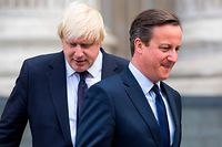 """(FILES) In this file photo taken on July 07, 2015 British Prime Minister David Cameron (R) and London Mayor Boris Johnson leave St Paul's Cathedral in central London after attending a memorial service in memory of the 52 victims of the 7/7 London attacks. - Former British prime minister David Cameron said Friday he had no regrets about launching the Brexit referendum but accused current PM Boris Johnson of behaving """"appallingly"""" during the pre-vote campaigning. (Photo by JACK TAYLOR / AFP)"""