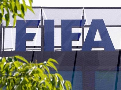 The logo of soccer's international governing body FIFA is seen on its headquarters in Zurich, Switzerland, May 27, 2015. Six soccer officials were arrested in Zurich on Wednesday and detained pending extradition to the United States over suspected corruption at soccer's governing body FIFA, the Swiss Federal Office of Justice said in a statement. REUTERS/Ruben Sprich