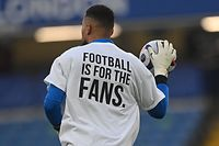 Brighton's Spanish goalkeeper Robert Sanchez wears an anti-European Super League t-shirt as he warms up ahead of the English Premier League football match between Chelsea and Brighton and Hove Albion at Stamford Bridge in London on April 20, 2021. (Photo by NEIL HALL / POOL / AFP) / RESTRICTED TO EDITORIAL USE. No use with unauthorized audio, video, data, fixture lists, club/league logos or 'live' services. Online in-match use limited to 120 images. An additional 40 images may be used in extra time. No video emulation. Social media in-match use limited to 120 images. An additional 40 images may be used in extra time. No use in betting publications, games or single club/league/player publications. /