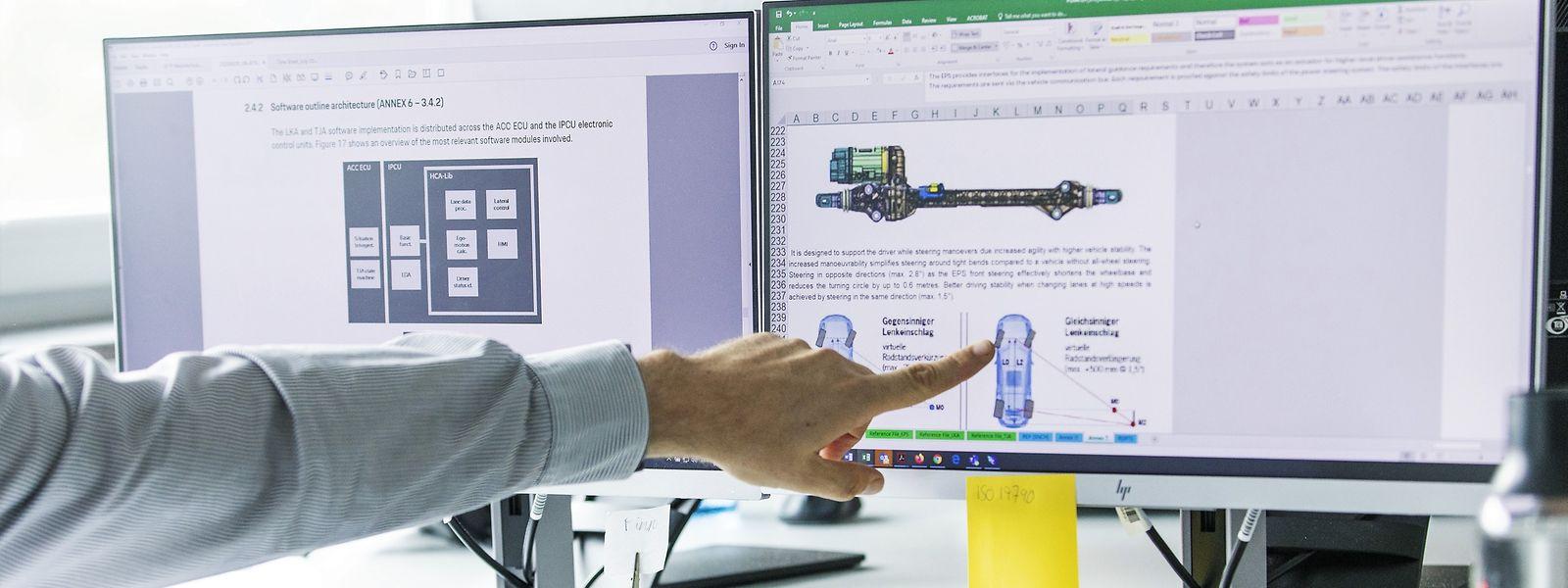 Ein Prüfungsschritt: Die Ingenieure bei Ateel sehen sich die technischen Details an, die die Fahrzeughersteller ihnen übermitteln.