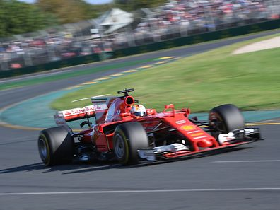 Ferrari's German driver Sebastian Vettel powers through a curve during the Formula One Australian Grand Prix in Melbourne on March 26, 2017. / AFP PHOTO / William WEST / -- IMAGE RESTRICTED TO EDITORIAL USE - STRICTLY NO COMMERCIAL USE --