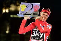 """(FILES) This file photo taken on September 10, 2017 shows Team Sky's British cyclist Chris Froome celebrating on the podium winning the 72nd edition of """"La Vuelta"""" Tour of Spain cycling race, in Madrid. Froome, four-time winner of the Tour de France, has been tested positive for the bronchodilator 'Salbutamol' during the 2017 Tour of Spain that he won, the International Cycling Union (UCI) said in a statement on December 13, 2017. / AFP PHOTO / JOSE JORDAN"""