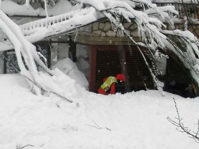 A rescuer taking part in the salvage operations in front of the  Hotel Rigopiano engulfed by a powerful avalanche in Farindola on January 19, after a 5.7-magnitude earthquake struck the region.