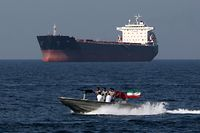 "(FILES) In this file photo taken on April 30, 2019, Iranian soldiers take part in the ""National Persian Gulf day"" in the Strait of Hormuz. - Iran on June 14 dismissed as ""baseless"" US accusations that it carried out twin attacks that left two tankers ablaze in the Gulf of Oman, escalating tensions across the region and sending world oil prices soaring. The two vessels were struck by explosions in the early daylight hours on June 13 after passing through the Strait of Hormuz and travelling around 25 nautical miles off Iran's southern coast headed towards Asia. (Photo by ATTA KENARE / AFP)"