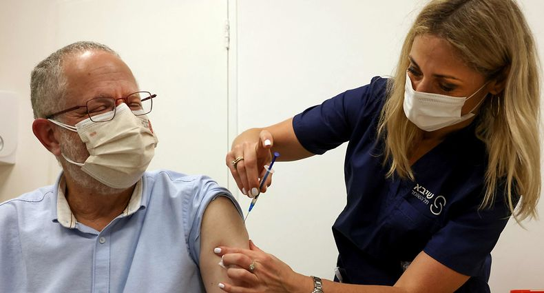An Israeli nurse injects a third dose of the Pfizer/BioNTech Covid-19 vaccine in Tel Aviv on July 30, 2021, as Israel launches its campaign to give booster shots to people aged over 60. (Photo by Emmanuel DUNAND / AFP)