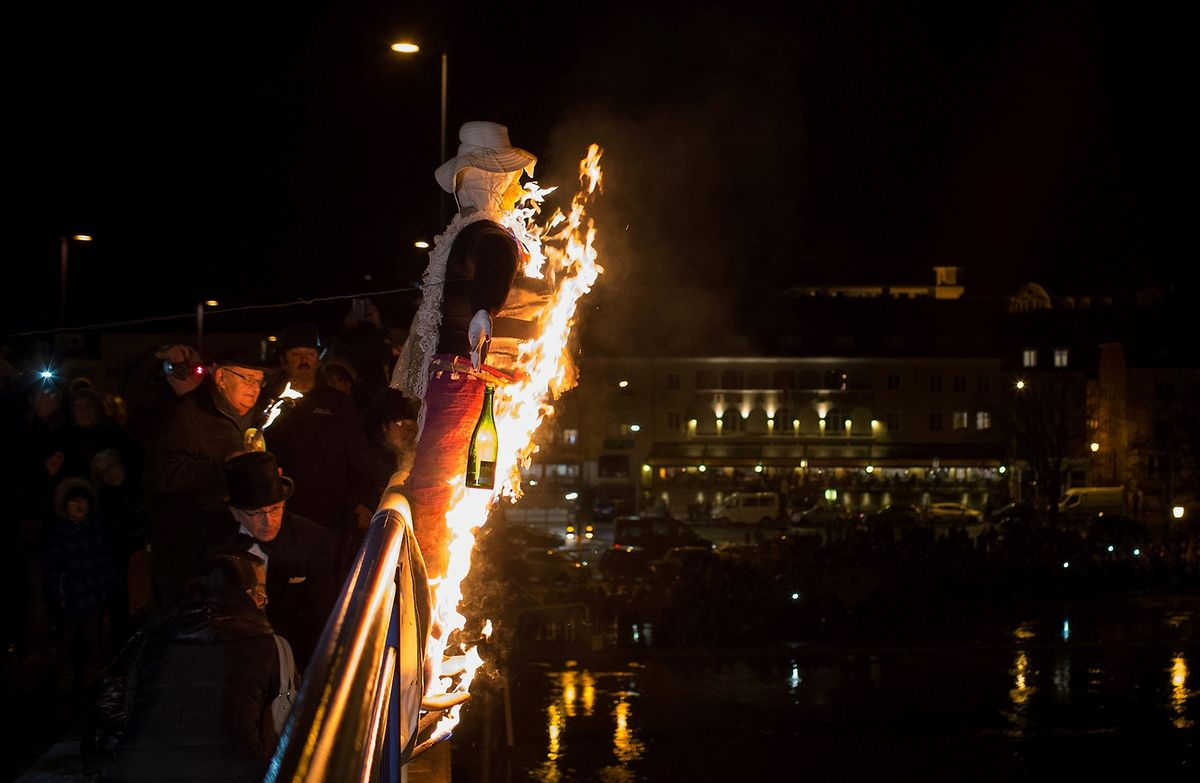 Burning of a straw man with an empty bottle of wine symbolising the excesses of Carnival Photo: Chris Karaba