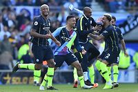 (L-R) Manchester City's Belgian defender Vincent Kompany, Manchester City's Brazilian striker Gabriel Jesus, Manchester City's Brazilian midfielder Fernandinho, Manchester City's English defender Kyle Walker celebrate at the final whistle of the English Premier League football match between Brighton and Hove Albion and Manchester City at the American Express Community Stadium in Brighton, southern England on May 12, 2019. - Manchester City held off a titanic challenge from Liverpool to become the first side in a decade to retain the Premier League on Sunday by coming from behind to beat Brighton 4-1 on Sunday. (Photo by Glyn KIRK / AFP) / RESTRICTED TO EDITORIAL USE. No use with unauthorized audio, video, data, fixture lists, club/league logos or 'live' services. Online in-match use limited to 120 images. An additional 40 images may be used in extra time. No video emulation. Social media in-match use limited to 120 images. An additional 40 images may be used in extra time. No use in betting publications, games or single club/league/player publications. /
