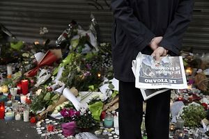 Flowers and candles are placed outside the Le Belle Equipe restaurant along the Rue de Charonne in central east Paris