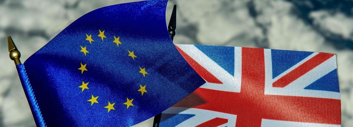 """This photo illustration created on May 20, 2016 in Lille shows the flags of the European Union and the United Kingdom.  On June 23, 2016 Great Britain will hold a referendum on whether or not the United Kingdom will remain within the European Union, often referred to as """"Brexit."""" Group of Seven finance ministers on May 21 warned of the risks from a """"shock"""" to the world economy if Britain votes to leave the European Union next month. / AFP PHOTO / PHILIPPE HUGUEN"""