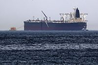 "A picture taken on May 13, 2019, shows the crude oil tanker, Amjad, which was one of two reported tankers that were damaged  in mysterious ""sabotage attacks"", off the coast of the Gulf emirate of Fujairah. - Saudi Arabia said two of its oil tankers were damaged in mysterious ""sabotage attacks"" in the Gulf as tensions soared in a region already shaken by a standoff between the United States and Iran. (Photo by KARIM SAHIB / AFP)"