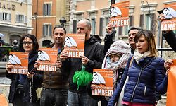 "Italian members of the support committee of French quadriplegic Vincent Lambert, hold a banner reading ""#I'm Vincent Lambert"" as they protest in front of Montecitorio, the Italian Parliament, in central Rome, on May 20, 2019. - Vincent Lambert, a quadriplegic man who has been in a vegetative state for the last decade, currently in Sebastopol hospital where doctors began switching off the life support. The dispute over the fate of Vincent Lambert has split his own family and even become a subject of political tension in France ahead of the weekend's European elections. (Photo by Andreas SOLARO / AFP)"