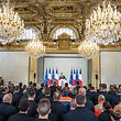 French President Emmanuel Macron (C) addresses Paris fire Brigade BSPP's staff and other emergency workers at the Elysee presidential Palace in Paris on April 18, 2019, during a tribute ceremony to those who saved Notre-Dame de Paris Cathedrale in the devastating blaze three days ago. (Photo by Christophe PETIT TESSON / EPA POOL / AFP)