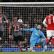 Bayern Munich's Chilean midfielder Arturo Vidal (2L) scores their fourth goal past Arsenal's Colombian goalkeeper David Ospina during the UEFA Champions League last 16 second leg football match between Arsenal and Bayern Munich at The Emirates Stadium in London on March 7, 2017. / AFP PHOTO / IKIMAGES / Ian KINGTON
