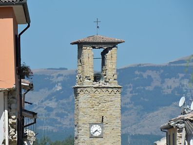 A picture taken on August 26, 2016 shows the damaged bell tower of the central Italian village of Amatrice, two day after a 6.2-magnitude earthquake struck the region killing some 267 people. An increasingly forlorn search for victims of the earthquake that brought carnage to central Italy entered a third day on August 26, 2016 as the confirmed death toll climbed to 267. At least 367 people have been hospitalised with injuries but no one has been pulled alive from the piles of collapsed masonry since August 24, 2016 evening.  / AFP PHOTO / ANDREAS SOLARO