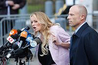 (FILES) In this file photo taken on April 16, 2018 adult-film actress Stephanie Clifford, also known as Stormy Daniels speaks outside US Federal Court with her lawyer Michael Avenatti (R) in Lower Manhattan, New York. Adult film star Stormy Daniels filed a defamation suit on April 30, 2018 against US President Donald Trump for a tweet in which he dismissed a composite sketch that Daniels says depicted a man who threatened her in 2011. / AFP PHOTO / EDUARDO MUNOZ ALVAREZ