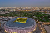"""(FILES) This file handout aerial picture received from Qatar's Supreme Committee for Delivery and Legacy on November 20, 2020, shows a view of the FIFA WC2022 Education City Stadium in al-Rayyan city. - Qatar will inaugurate its latest completed World Cup stadium with a domestic fixture at which half of tickets will be reserved for fans who have recovered from coronavirus, the country's FA said Monday. (Photo by - / Qatar�s Supreme Committee for Delivery and Legacy / AFP) / == RESTRICTED TO EDITORIAL USE - MANDATORY CREDIT """"AFP PHOTO / HO / QATAR'S SUPREME COMMITTEE FOR DELIVERY AND LEGACY"""" - NO MARKETING NO ADVERTISING CAMPAIGNS - DISTRIBUTED AS A SERVICE TO CLIENTS =="""