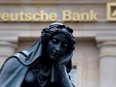 A statue is seen next to the logo of Germany's Deutsche Bank in Frankfurt, Germany, January 26, 2016.    REUTERS/Kai Pfaffenbach/File Photo      TPX IMAGES OF THE DAY