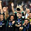 Real Madrid's players celebrate with the trophy after winning the UEFA Super Cup football match between Real Madrid and Manchester United on August 8, 2017, at the Philip II Arena in Skopje. / AFP PHOTO / Dimitar DILKOFF