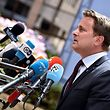 Luxembourg's Prime minister Xavier Bettel talks to the press as he arrives before an EU summit meeting on June 28, 2016 at the European Union headquarters in Brussels.  / AFP PHOTO / PHILIPPE HUGUEN