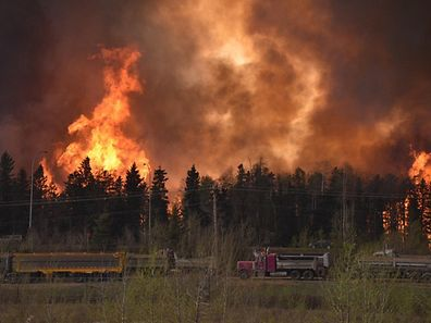 Wildfire is worsening along highway 63 Fort McMurray, Alberta Canada May 3, 2016. The whole city of Fort McMurray, Alberta, the gateway to Canada's oil sands region, is under a mandatory evacuation order because of an uncontrolled wildfire that is rapidly spreading, local authorities said on Tuesday.  Courtesy CBC News/Handout via REUTERS   ATTENTION EDITORS - THIS IMAGE WAS PROVIDED BY A THIRD PARTY. EDITORIAL USE ONLY. NO RESALES. NO ARCHIVE.  MANDATORY CREDIT. ONE TIME USE ONLY