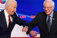 TOPSHOT - Democratic presidential hopefuls former US vice president Joe Biden (L) and Senator Bernie Sanders greet each other with a safe elbow bump before the start of the 11th Democratic Party 2020 presidential debate in a CNN Washington Bureau studio in Washington, DC on March 15, 2020. (Photo by Mandel NGAN / AFP)