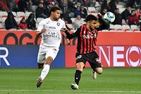 Metz's French defender Mathieu Udol (L) fights for the ball with Nice's Algerian forward Adam Ounas during the French L1 football match between Nice (OGCN) and Metz (FCM) at the Allianz Riviera stadium, in Nice, southeastern France on December 7, 2019. (Photo by GERARD JULIEN / AFP)