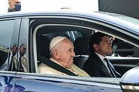 Pope Francis arrives by car to celebrate mass at the tomb of St. Francis in Assisi on October 3, 2020 and later sign a new encyclical on human fraternity titled �Fratelli Tutti�. (Photo by Tiziana FABI / AFP)