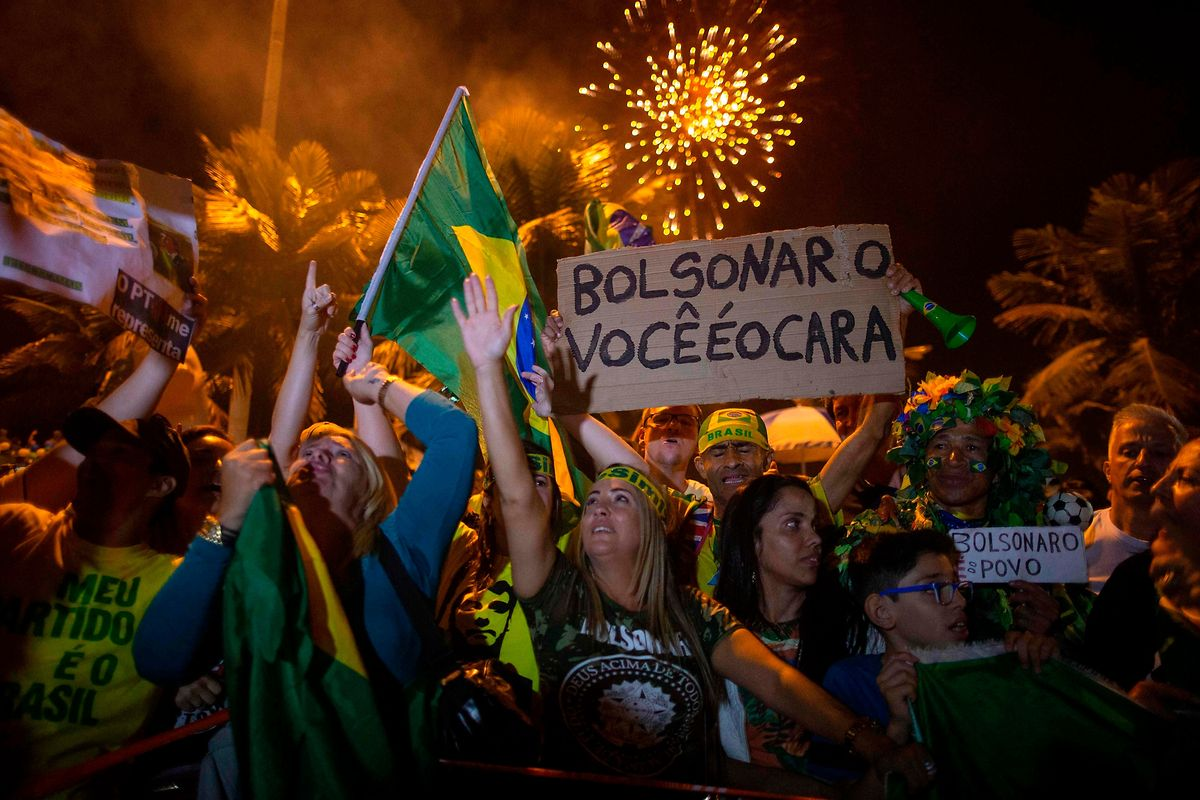 Supporters of far-right presidential candidate Jair Bolsonaro, celebrate in front of his house in Rio de Janeiro, Brazil, after he won Brazil's presidential election Photo: AFP