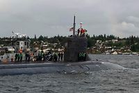 """In this image released by the US Navy, The Seawolf-class fast-attack submarine USS Connecticut (SSN 22) departs Naval Base Kitsap-Bremerton for deployment in Bremerton, Washington on May 27, 2021. - A US nuclear submarine was damaged after hitting an unidentified object while operating underwater in Asia, the US Navy said. The USS Connecticut, a nuclear-powered fast-attack submarine, """"struck an object while submerged on the afternoon of Oct. 2, while operating in international waters in the Indo-Pacific region,"""" the navy said in a statement. (Photo by Lt. Mack Jamieson / US NAVY / AFP) / RESTRICTED TO EDITORIAL USE - MANDATORY CREDIT """"AFP PHOTO / US Navy/ Lt. Mack JAMIESON"""" - NO MARKETING - NO ADVERTISING CAMPAIGNS - DISTRIBUTED AS A SERVICE TO CLIENTS"""