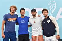 """(FILES) In this file photo taken on June 12, 2020 (LtoR) German tennis player Alexander """"Sascha"""" Zverev, Serbian tennis player Novak Djokovic, Bulgarian tennis player Grigor Dimitrov and Austrian tennis player Dominic Thiem pose for a photo after a press conference of the Adria Tour, a charity exhibition hosted by Novak Djokovic, in Belgrade. - Novak Djokovic has also tested positive for coronavirus on June 23, 2020 along with Grigor Dimitrov, Borna Coric and Viktor Troicki, after taking part in an exhibition tennis tournament in the Balkans featuring world number one Novak Djokovic, raising questions over the sport's planned return in August. (Photo by Andrej ISAKOVIC / AFP)"""