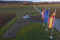 This picture taken with a drone on January 20, 2020, shows the geographic center of the European Union after Brexit in the Gadheim district of Veitshoechheim near Wuerzburg, southern Germany. - In the tiny village of Gadheim in northern Bavaria, a lovingly laid out garden marked with regional, German and European flags marks the spot that will stand at the geographic centre of the European Union after Brexit. (Photo by Yann Schreiber / AFP)