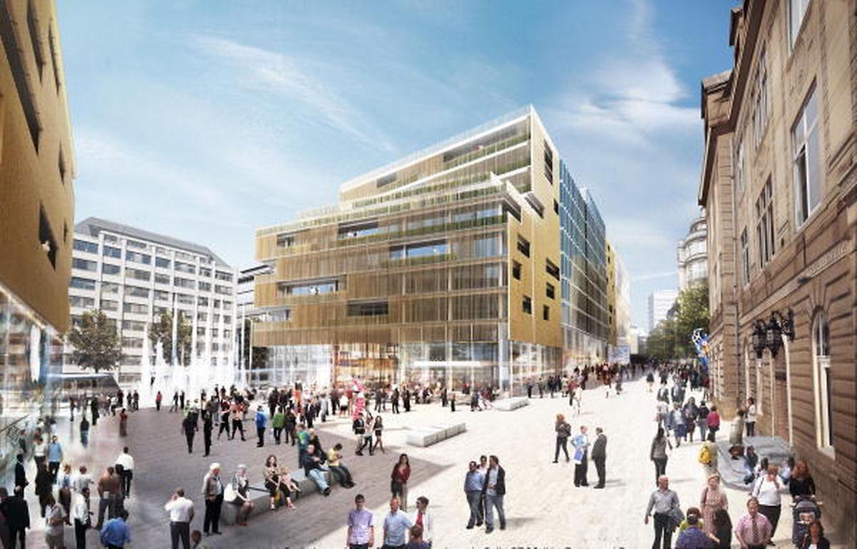 La future place Aldringen, de forme trapézoïdale, sera 100% piétonne. Les deux quais du tram et les quais des bus longeront la place, côté boulevard Royal. Sur cette vue, on reconnaît la Poste à droite.