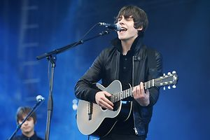 Jake Bugg performs at the Isle of Wight Festival in Newport on the Isle of Wight on Friday, June 14, 2013. Thousands of people are to attend the three day event with headliners, the Stone Roses, the Killers and Bon Jovi.(Photo by Jim Ross/Invision/AP)