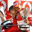 Ferrari Formula One driver Michael Schumacher (R) of Germany embraces Ferrari team manager Jean Todt of France on the podium after winning the Italian Grand Prix at the Monza race track in northern Italy September 10, 2006. Schumacher, the most successful Formula One driver of all time, announced on Sunday that he was retiring from the sport at the end of the season.     REUTERS/Giampiero Sposito (ITALY)