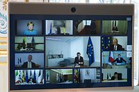 A picture shows a screen of a video conference call between members of the European Council, seen at the Elysee Palace in Paris, on March 26, 2020, to discuss coordination of EU efforts to tackle the outbreak of COVID-19 (novel coronavius), as well as other issues, including foreign affairs, digital policy and enlargement. - EU leaders will try on March 26 to unify their scattershot response to the COVID-19 epidemic, after hardest-hit Spain, France and Italy called for joint borrowing to share the economic burden. Hundreds of millions of the bloc's citizens are holed up at home, during lockdowns imposed to help slow the pandemic that has killed more than 20,000 Europeans and crippled business life. (Photo by Ian LANGSDON / POOL / AFP)