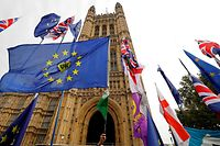 EU and Union flags belonging to Brexit activists fly outside the Houses of Parliament in London on October 23, 2019. - British Prime Minister Boris Johnson could pivot towards a general election as the EU mulls granting a Brexit deadline extension on Wednesday, after a fresh twist to the divorce saga cast doubt over his hopes of leaving on October 31. In tense parliamentary votes on Tuesday, Johnson won initial backing for the divorce deal he agreed with the EU -- but MPs then rejected his timetable to rush it through parliament in a matter of days. (Photo by Tolga Akmen / AFP)