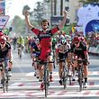 """BMC Racing Team's Luxembourgian cyclist Jean-Pierre Drucker (C) celebrates winning as he crosses the finish line during the 16th stage of the 71st edition of """"La Vuelta"""" Tour of Spain, a 158km route Alcaniz to Peniscola, on September 5, 2016. / AFP PHOTO / JOSE JORDAN"""